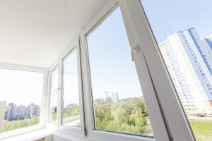 White metal-plastic windows of balcony in modern apartment